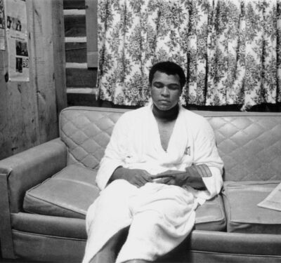 Muhammad Ali relaxes after a workout at his Deer Lake training camp in 1978.