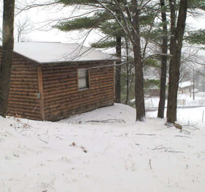"""One of the cabins at Muhammad Ali's rustic Deer Lake training camp. The cabins housed staff, sparring partners, and various guests and celebrities who came to call on """"The Greatest""""."""